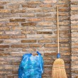 Household Broom For Floor Cleaning and Garbage Bag — Stock Photo #71293679