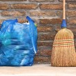 Household Broom For Floor Cleaning and Garbage Bag — Stock Photo #71293763