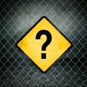 Question Mark Grunge Yellow Warning Sign on Chainlink Fence — Stock Photo