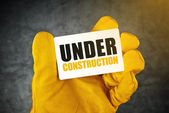 Under Construction on Business Card — Stock Photo