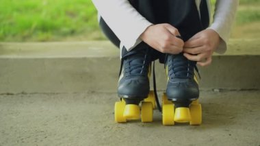 Woman Ties Laces on Vintage Retro Quad Roller Skates, Sitting on Concrete Block in Urban Environment — Stock Video