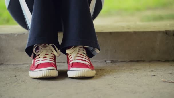 Young Teenage Woman in Red Sneakers Tapping Feet and Waiting for Someone — Vídeo de stock