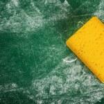 Yellow Sponge and Green Chalkboard — Stock Photo #72429325