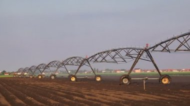 Automated Farming Irrigation Sprinklers System in Operation on Cultivated Agricultural Field — Stock Video