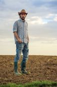 Male Farmer Standing on Fertile Agricultural Farm Land Soil — Stock Photo