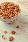 Walnut Kernels in Bowl on Rustic Wooden Background — Stock Photo