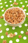 Walnut Kernels in Bowl on Polka Dotted Background — Stock Photo
