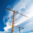 Cranes Working on Construction Site — Stock Photo #79655928