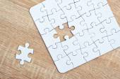 Piece missing from jigsaw puzzle on wooden table — Stock Photo