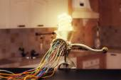 Mincing machine is grinding up a lamp — Stock Photo