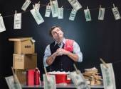 Glad businessman is laundering money — Stock Photo