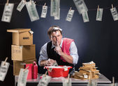 Businessman is laundering money in foam — Stock Photo