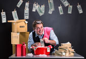 Happy businessman is laundering money — Stock Photo