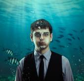 Businessman with fishes — Stock Photo