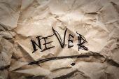 Inscription never — Stock Photo
