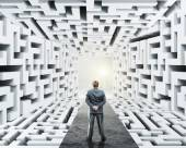 Businessman standing surrounded by labyrinth — Foto Stock
