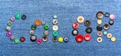 Colorful buttons forming the word 'color' — Stock Photo