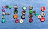 Colorful buttons forming the word 'fun' — Stock Photo