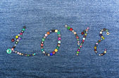 Colorful buttons forming the word 'love' — Stock Photo