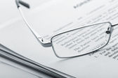 Glasses on the newspaper — Stock Photo