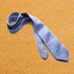 Blue necktie on sand — Stock Photo #63300667
