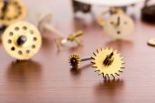 Gears on wooden table — Stock Photo
