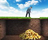 Businessman found treasure in the soil — Stock Photo