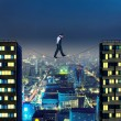 Businessman thinking going the tightrope — Stock Photo #64224511