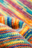Knitted colorful scarf — Stock Photo
