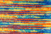 Knitted multicolored scarf in closeup — Stock Photo