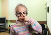 Serious little girl in glasses — Stock Photo