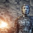 Metal human statue covered with letters — Stock Photo #69589909