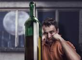 Drunk man with bottle of wine — Stock Photo