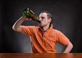 Man drinks alcohol — Stock Photo