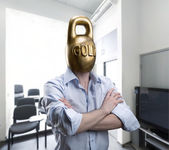Businessman with gold kettlebell head — Stock Photo