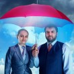 Business couple under umbrella — Stock Photo #70783567