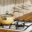 Pan on the stove in kitchen — Stock Photo #72042577