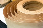 Closeup of veneer in a roll — Stock Photo