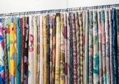 Different fabrics on stand — Stock Photo