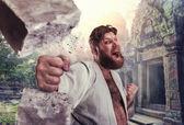 Strong karateka breaks brick — Stock Photo