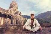 Karate fighter meditating — Stock Photo