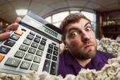 Man holding calculator — Stock Photo