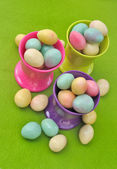 Easter eggs in egg cups — Stock Photo