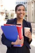 Business woman with coffee and folders. — Stock Photo