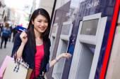 Girl at cash machine — Stock Photo
