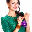 Beautiful young woman with a purple Christmas bauble — Stok fotoğraf #58948181
