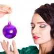 Beautiful young woman with a purple Christmas bauble — Foto de Stock   #58948489