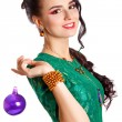 Beautiful young woman with a purple Christmas bauble — Stok fotoğraf #58949627