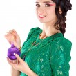 Beautiful young woman with a purple Christmas bauble — Stok fotoğraf #58949903
