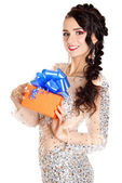 Beautiful young woman with a bright gift — Stock Photo